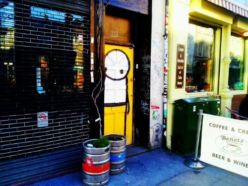Look over the road once you reach the end of Brick Lane and this little chap from Stik peers out from a doorway