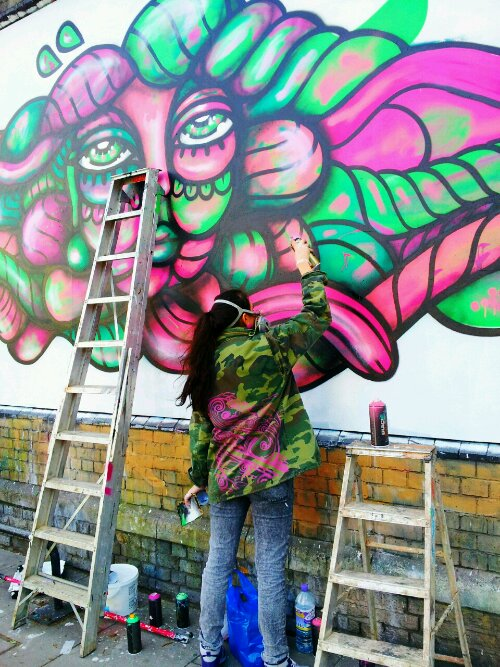 Amara Por Dios in action on Great Eastern Street next to the Bear Gallery where she held a solo show in 2013