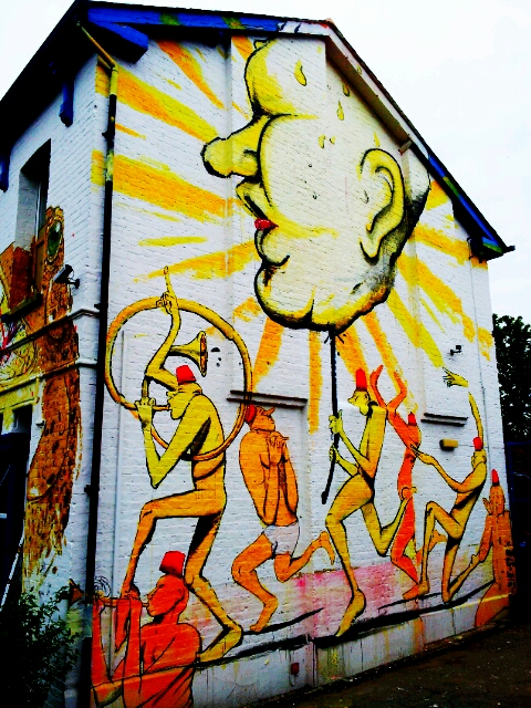 Street Artist RUN re-imagined 'The Triumph of David' by Nicolas Poussin on the side of a house