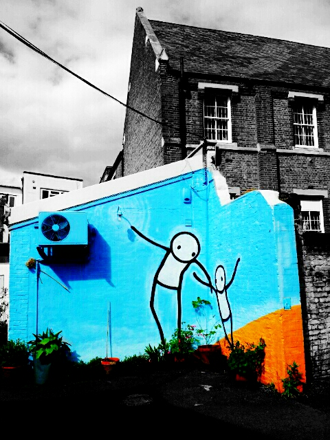 The Guardian Angel by Stik on the wall of a dance studio