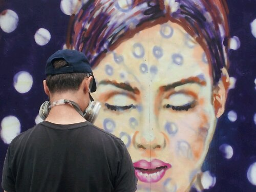 Jimmy C in action painting on Whitecross Street