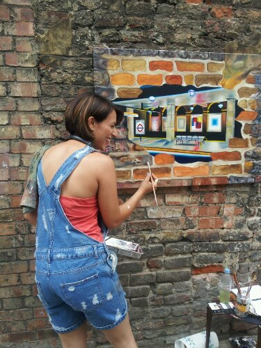 Andrea Tyrimos painting on Whitecross Street in 2013