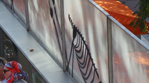 Ben Murphy didn't have the luxury of shade as he produced his tape art by the fountains