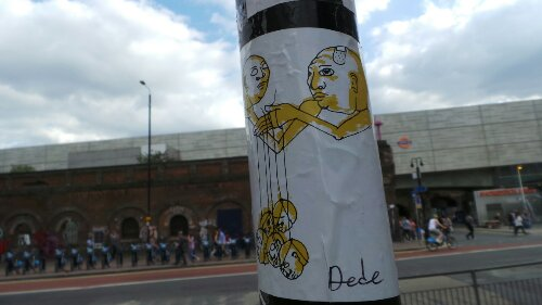 Dede has been producing paste ups, painted street art and now a few stickers.  This is on Bethnal Green Road