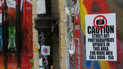 The Brick Lane car park is awash with stickers and paste ups.