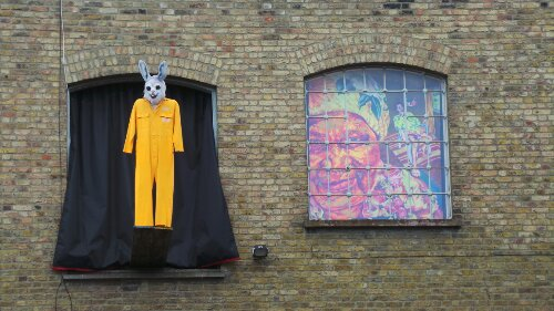 Random art high on a building next to the Hackney Pearl
