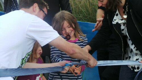 A local girl had the honour of officially opening the mural helped by Lee Bofkin and Cllr Coghill