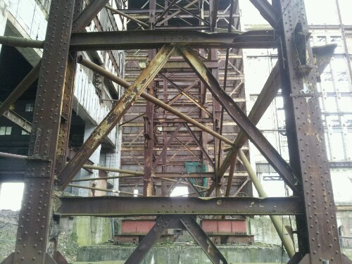 The steel girders the make up the structure are rusting away