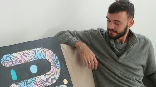 Kef at home with one of his latest abstract canvases