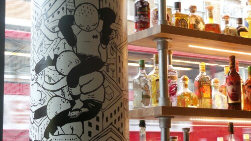 A pillar by Millo with Yvonne Waylings bottles in the background