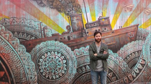 Beau by the final mural