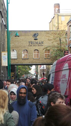 Looking down Brick Lane from Hanbury Street towards the Truman Brewery complex