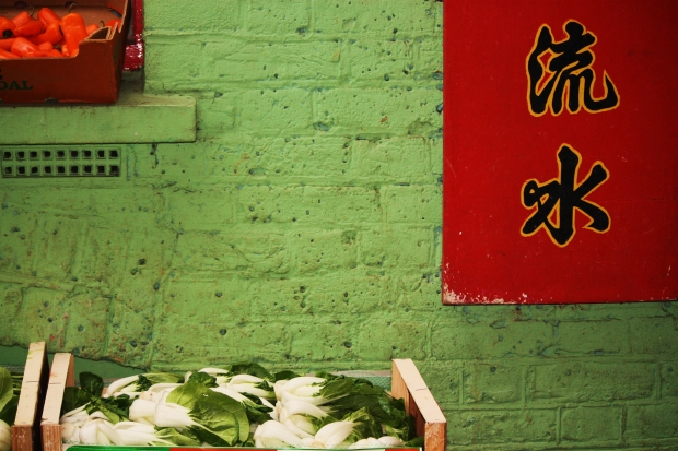 This image was taken in Chinatown with the symbols in the corner representing a differing facet of life in the area.  Picture by Stephanie Sadler
