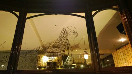 Benjamin Murphy's tape art on the window of the pub