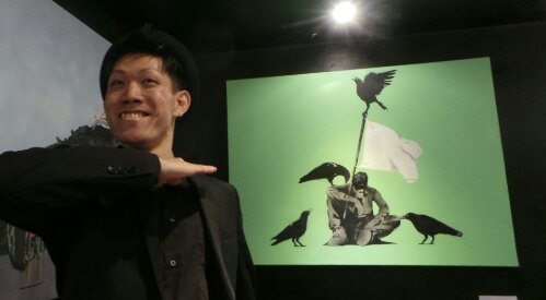 AITO poses by his piece 'Beginning of Rot'