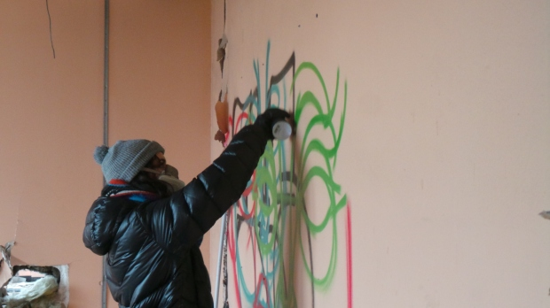 Amara works quick and was soon sketching out her mural