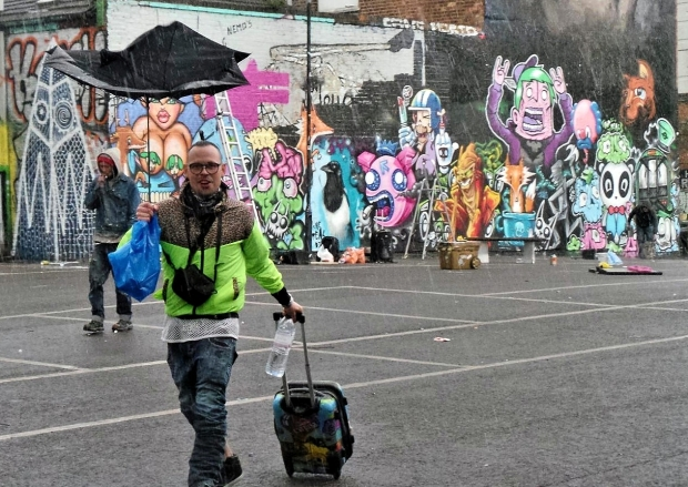A popular figure on the street art scene although perhaps one in need of umbrella buying advice