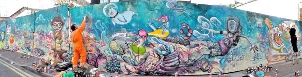 Ed Hicks and Anna Rewinska finish off their mural