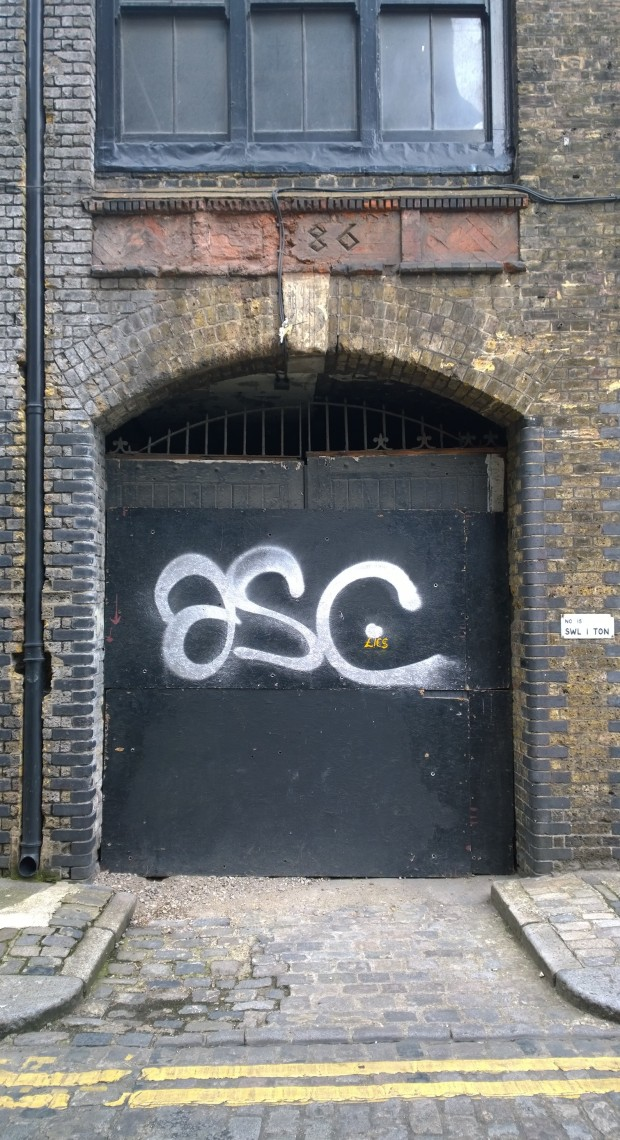 An original doorway to the warehouse with the date above