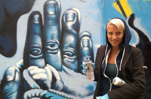 Zina next to her mural on Chance Street