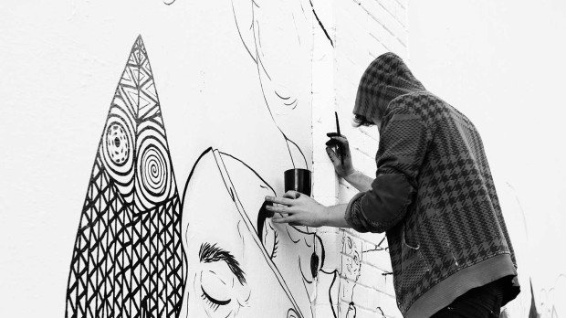 Benjamin Murphy painting the Shoreditch Art Wall.  Photo courtesy of Daniel Lucas