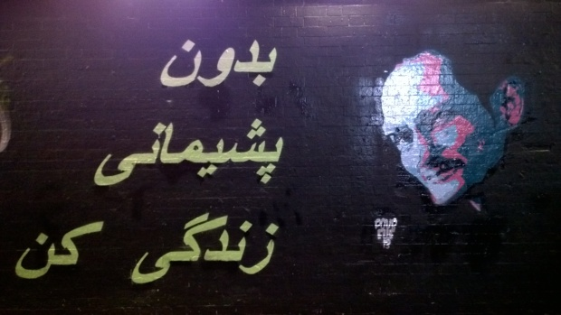 Ben Naz with 'Live Life Without Regrets' written in Farsi by Elle and Mike