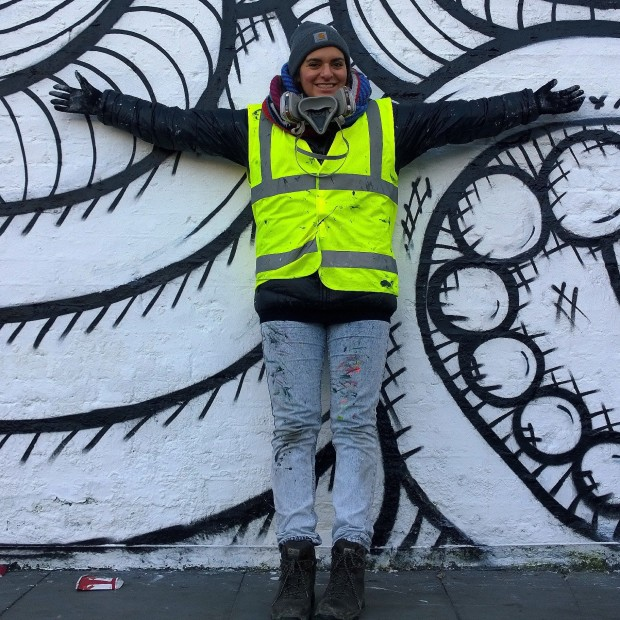 Amara on day three out of five painting the Village Underground wall