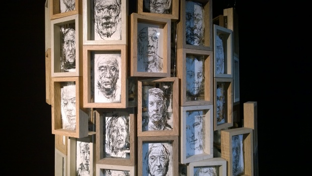 Faces on a pillar