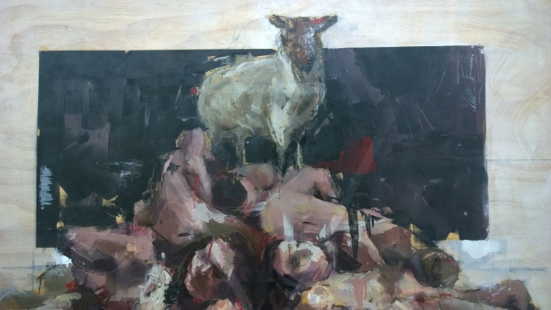Sheep standing atop a pile of bodies