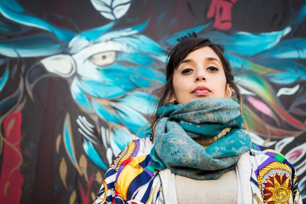 Fio Silva outside her wall in the centre of Shoreditch.  Photo by Rob Wilson Jnr