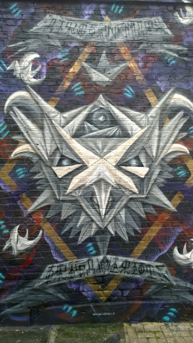 Airborne Mark has often painted in Camden and this owl in Camden was part of his 'Origami Riots' series