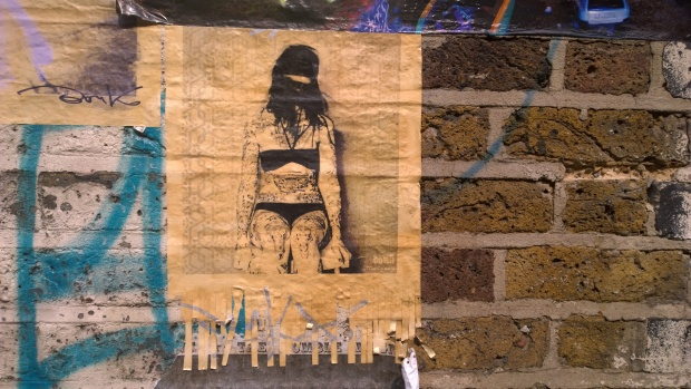 Tattooed woman on Fashion Street