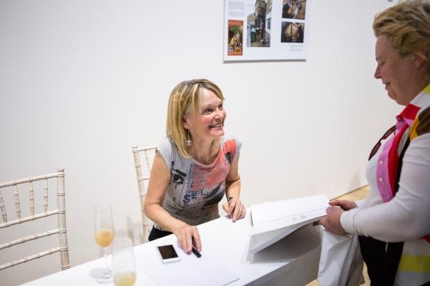 Ingrid Beazley signing books at the opening