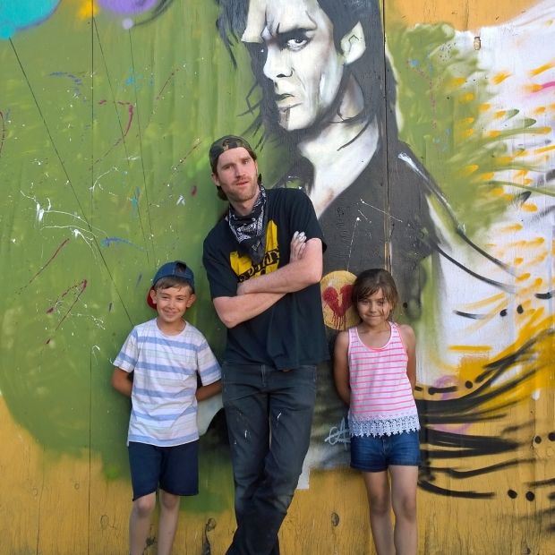 Gary Alford complete with some young fans and his portrait of Nick Cave