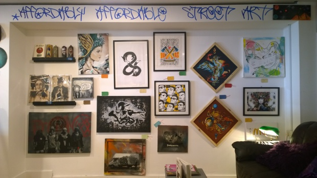 One of the walls of the Affordably Affordable Art Boutique