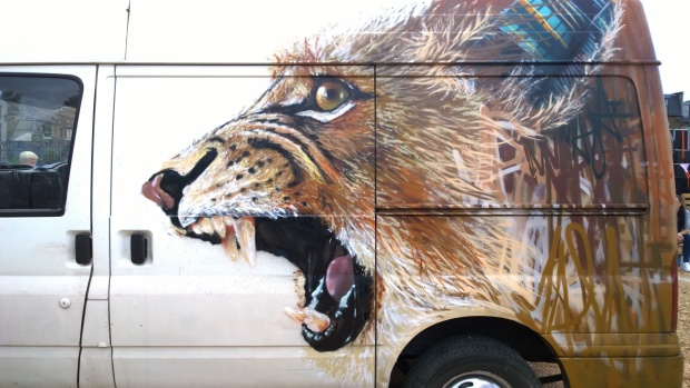 The finished Louis Masai piece was completed on the side of a van